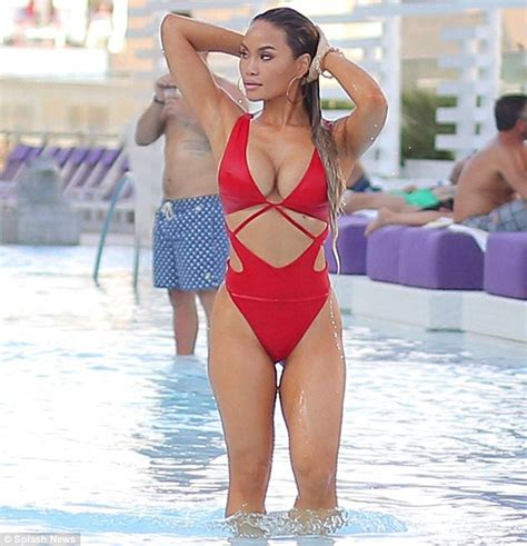 nina proll swimsuit daphne joy shows off her curves in a low cut swimsuit