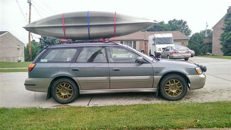 subaru forester rally wheels gold wheels kayaks rally lights and mudflaps all the