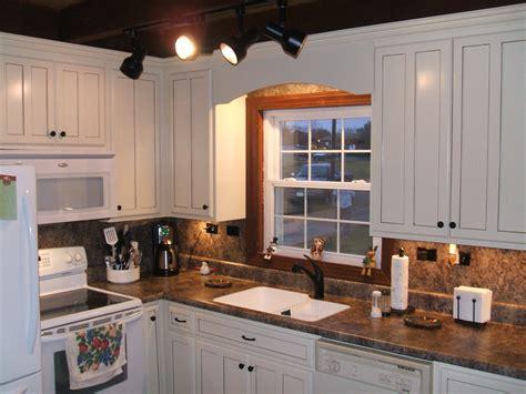 black kitchen wall cabinets white backsplash brown cabinets www sudarshanaloka org 4725