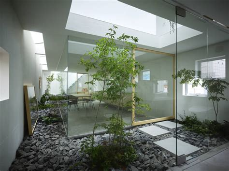 sliding glass doors and small rocks in indoor landscape