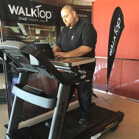 working while walking with the walktop treadmill desk big