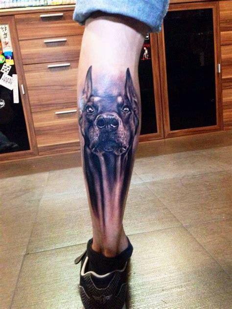 black ink doberman dog tattoo  men  shin
