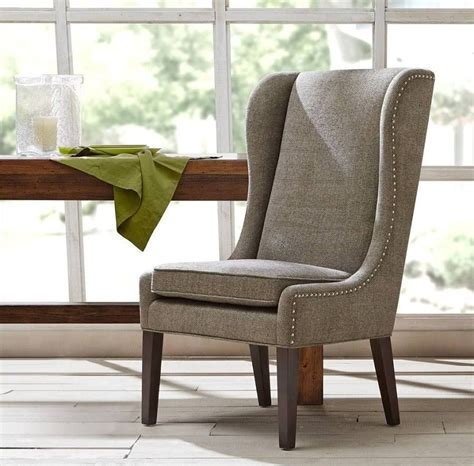Amory high back arm chair a comfortable and soft armchair that features a long backrest for even more convenience. upholstered captains dining chair   High back dining ...