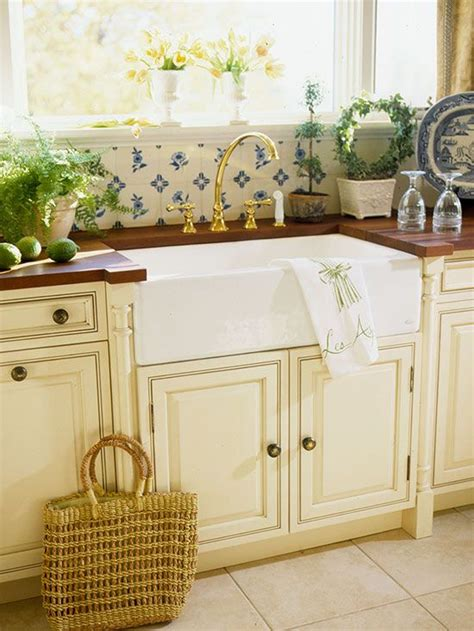 farmhouse sink cabinet ideas kitchen with blue and white backsplash cream cabinets and