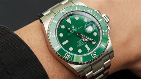 rolex submariner 116610lv green 40 mm stainless steel swiss luxury shining on