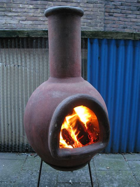 Put a piece of fired clay in a bucket of water some fire pits have chimneys, but the 360 degree opening prohibits proper drafting. Chimenea - Wikipedia