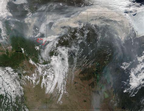 nasa satellites image fort mcmurray fires day  night