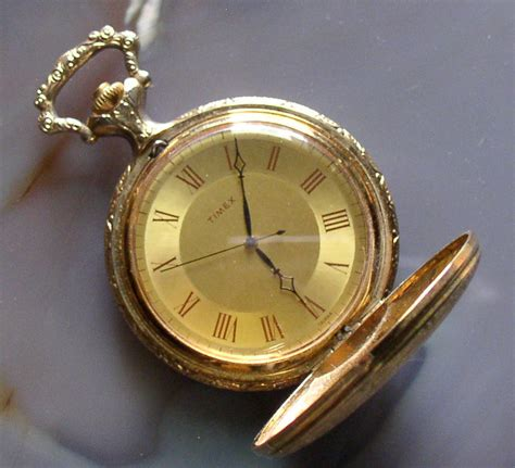 timex hunter case pocket  gold plated runs thingery