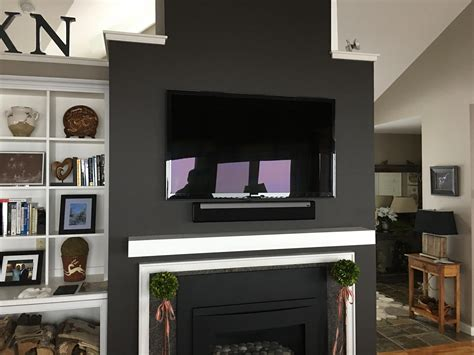 contemporary fireplace with professional tv installation
