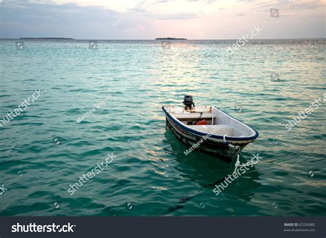Small Boat On The Ocean by Small Boat In The Ocean Stock Photo 67226980 Shutterstock