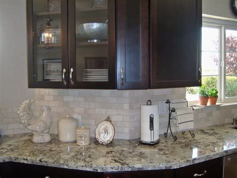 brown also called alaska white granite countertops with brown cabinets and a light