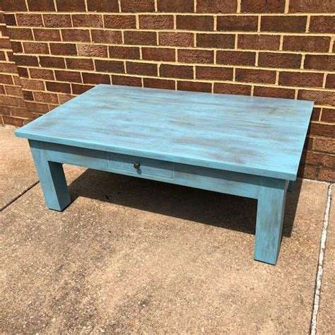 It is a modern coffee table that has got a solid wood construction. Primitive Coffee Table - Nadeau Alexandria