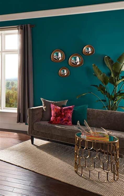 a rich teal hue of behr premium plus ultra coats the walls