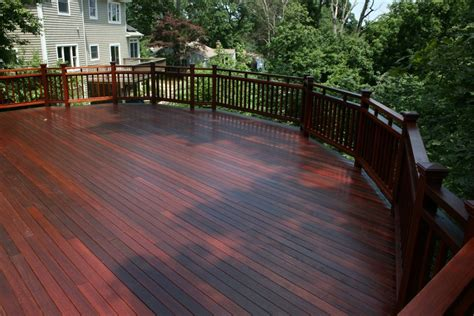 traditional porch deck with mahogany wood deck paint color