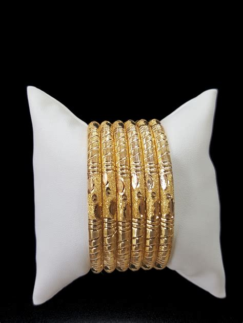 gold bangle set  alquds jewelry