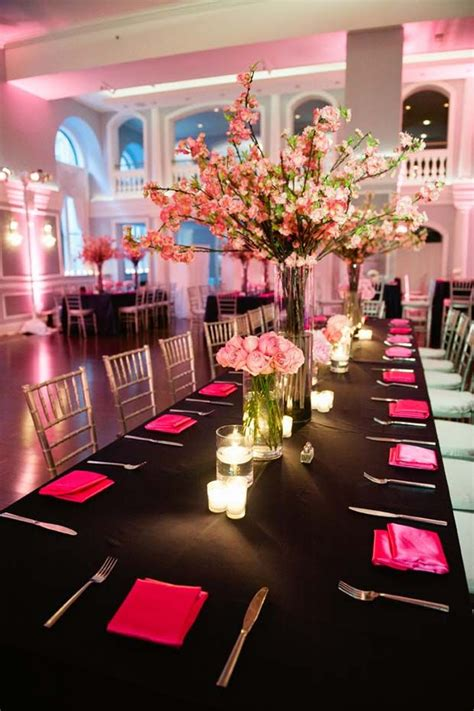 hot pink napkins and pink flowers on a black table love
