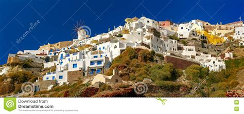 Windmill And White Houses Oia Santorini Greece Stock
