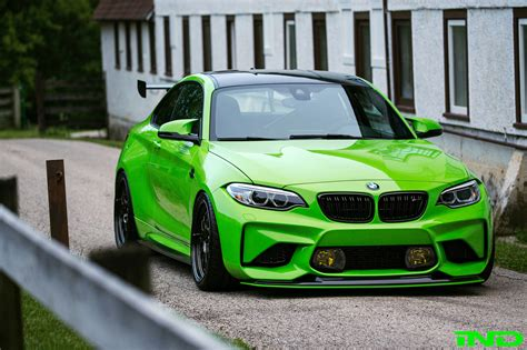 ind delivers a green bmw m2 coupe