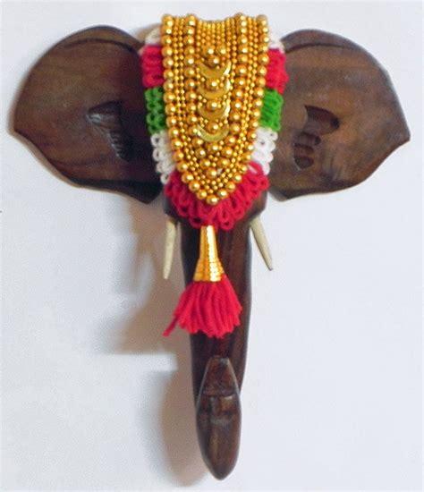 decorated elephant face wall hanging wood kerala