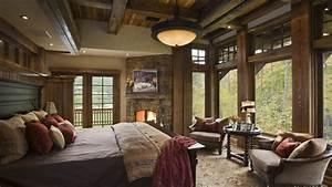 Rustic Master Bedroom With Stone Fireplace Flush Light
