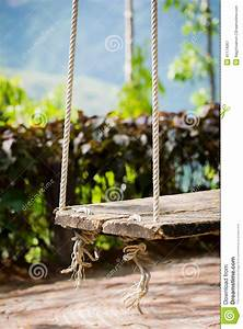 Old Wooden Vintage Garden Swing Hanging From A Large Tree ...