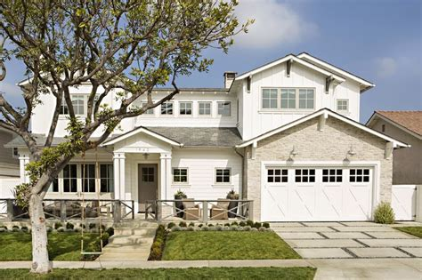 Classic White And Stone Exterior With A Barnstyle Garage