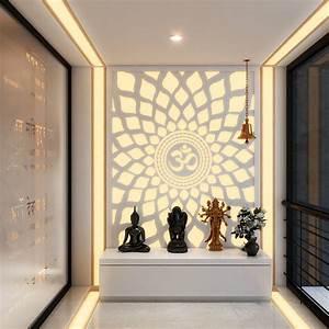 A hypnotic 'Aum' back lit panel in the Pooja room Pooja