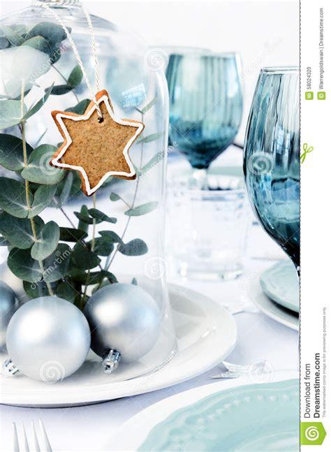 blue christmas dinner table setting  glass dome
