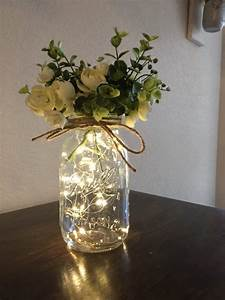 quart size jar with lights and flowers
