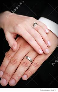 human body parts bride and groom wedding ring hands With wedding rings on hands photos