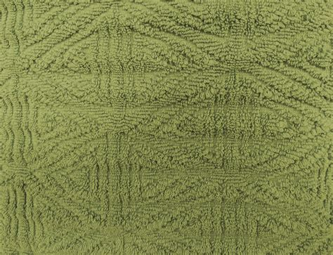 olive green textured throw rug close  picture