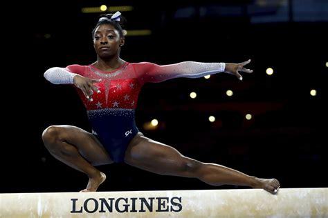 simone biles sets  record   wins world gymnastics
