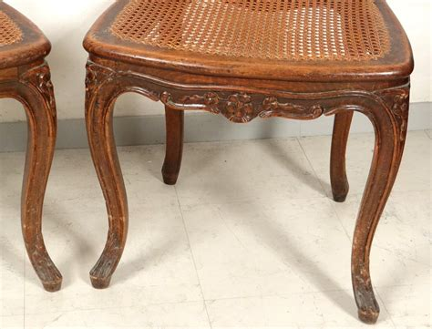 louis xv carved walnut chairs pair caned acanthus flowers