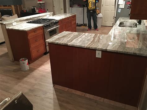 granite countertops with brown cabinets brown fantasy quartzite countertops by granite perfection