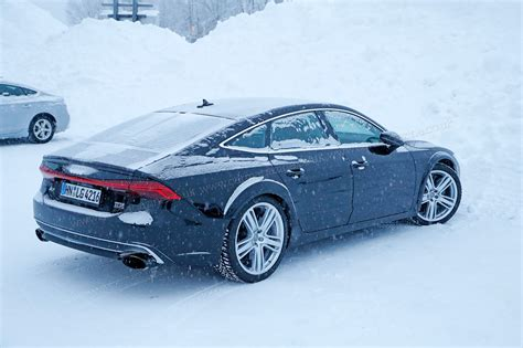 audi rs7 2019 spy shots brute in a suit gets snowy
