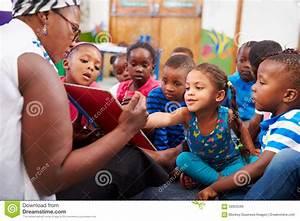Teacher Reading A Book With A Class Of Preschool Children ...