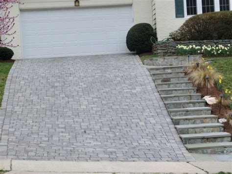 sloped paver driveway with steps driveways