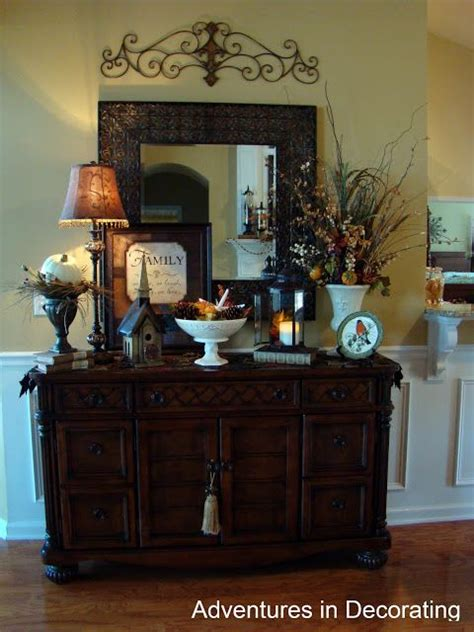 Buy wooden, glass and stainless steel sideboards. metal piece above mirror over buffet - LOVE this for the formal dining room   Decorating ...
