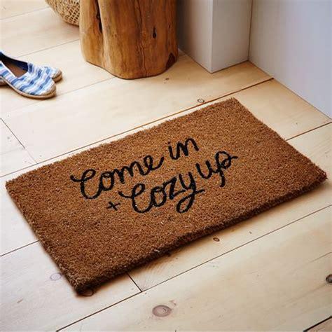 west elm doormat west elm come in and cozy up doormat rank style