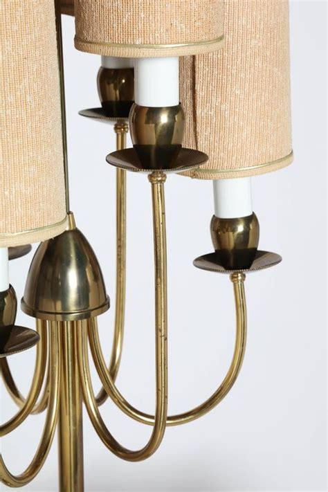 1950s parzinger style six candlestick and six shade brass