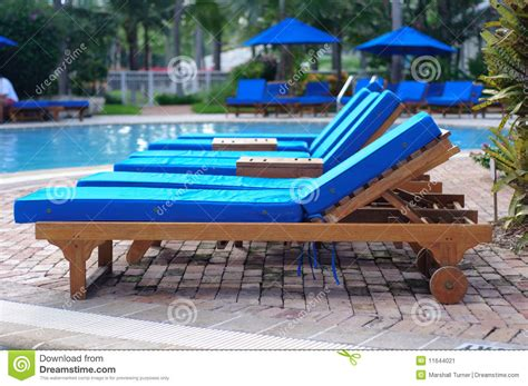 chaise lounge chairs by the pool stock image image 11644021