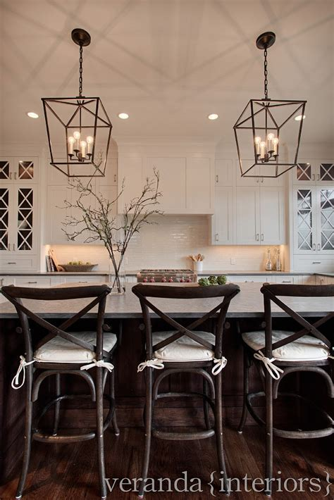 Kitchen Restoration Ideas - white kitchen cross mullions on glass windows dark floors pendant lighting ikea decora