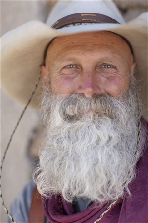 cowboy   long white beard stock photo