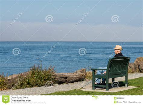 older man sitting    sea royalty  stock