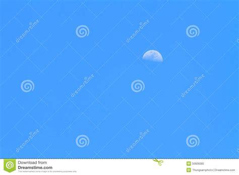 Half Moon In Blue Sky Stock Photo