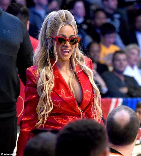 Cardi B wears a plunging red jacket at NBA All-Star Game ...