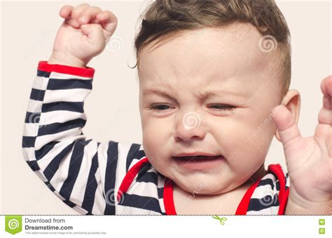 Cute Baby Boy Crying Raising His Hands Up Stock Photo