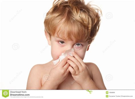 Sick Child Wiping His Nose Royalty Free Stock Image