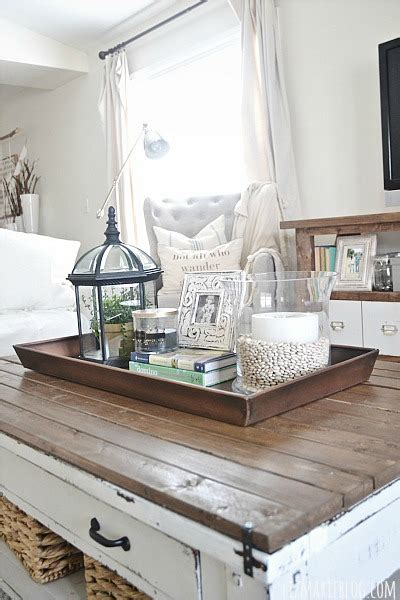 A coffee table could become one of the most interesting things in your room. DIY Boot Tray To Coffee Table Organizer - Liz Marie Blog