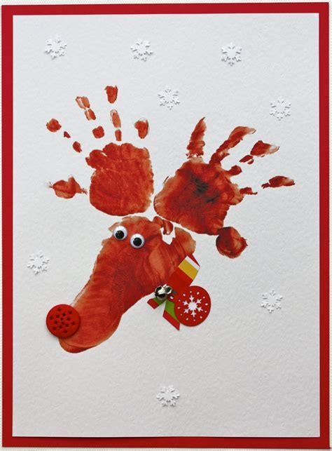 hand and footprint christmas crafts footprint reindeer cards